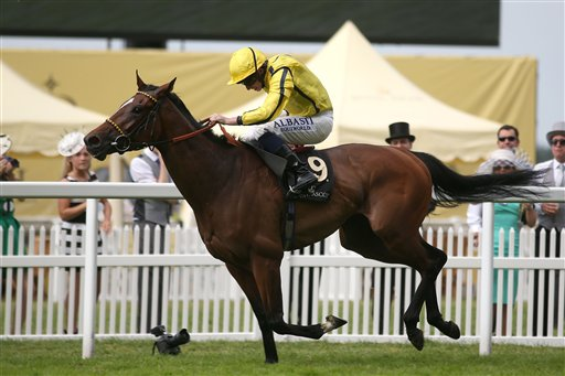 Rizeena ridden by Ryan Moore wins the Coronation Stakes during day four of the 2014 Royal Ascot Meeting at Ascot Racecourse, southern England, Friday June 20, 2014. (AP Photo/PA, Steve Parsons)