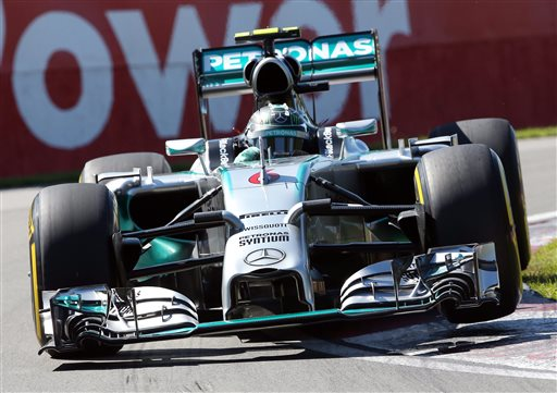 Mercedes driver Nico Rosberg from Germany goes over a curb during the morning practice session at Circuit Gilles Villeneuve Saturday, June 7, 2014 in Montreal. Rosberg will start from pole position in the Canadian Grand Prix Sunday, June 8, 2014.  (AP Photo/The Canadian Press, Tom Boland)