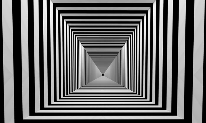 Tunnel with black and white stripes. (*Shutterstock)