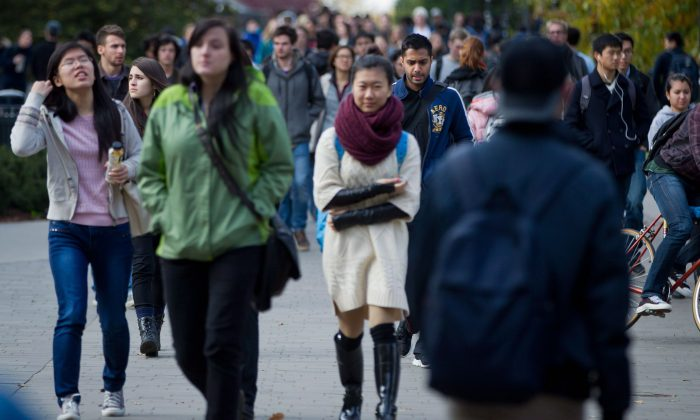 Students walk on the campus at the University of British Columbia in Vancouver. A new online survey shows that parents are increasing their expenses and debt to help pay for their children's education. (The Canadian Press/Darryl Dyck)