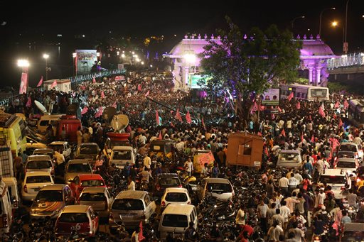 In this Sunday, June 1, 2014, photo, close to midnight, people celebrate on the street the formation of India's 29th state, Telangana, in Hyderabad, India. Celebrations greeted the creation Monday of India's newest state of Telangana, marking the formal division of the southern state of Andhra Pradesh. (AP Photo/Mahesh Kumar A.)
