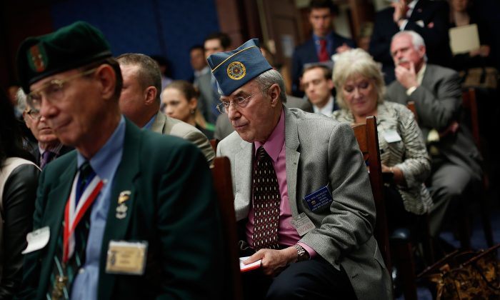 U.S. Army retired Col. Herb Rosenbleeth (C) listens to opening remarks by members of Congress during a meeting of the Senate-House Veterans Affairs Conference Committee at the U.S. Capitol in Washington, D.C., on June 24, 2014. (Win McNamee/Getty Images)