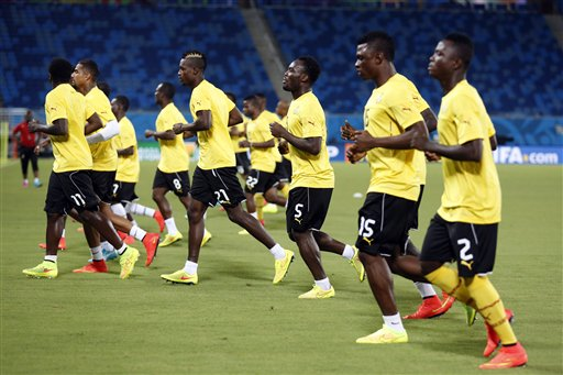 Ghana players warm up during an official training session the day before the group G World Cup soccer match between Ghana and the United States at the Arena das Dunas in Natal, Brazil, Sunday, June 15, 2014. (AP Photo/Dolores Ochoa)