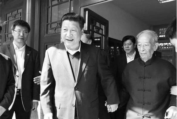 Chinese Communist Party leader Xi Jinping holds the hand of Tang Yijie, an 87-year-old professor of philosophy at Peking University, on May 4. Tang was a known supporter of the student movement in 1989. (Screenshot via Xinhuanet.com)