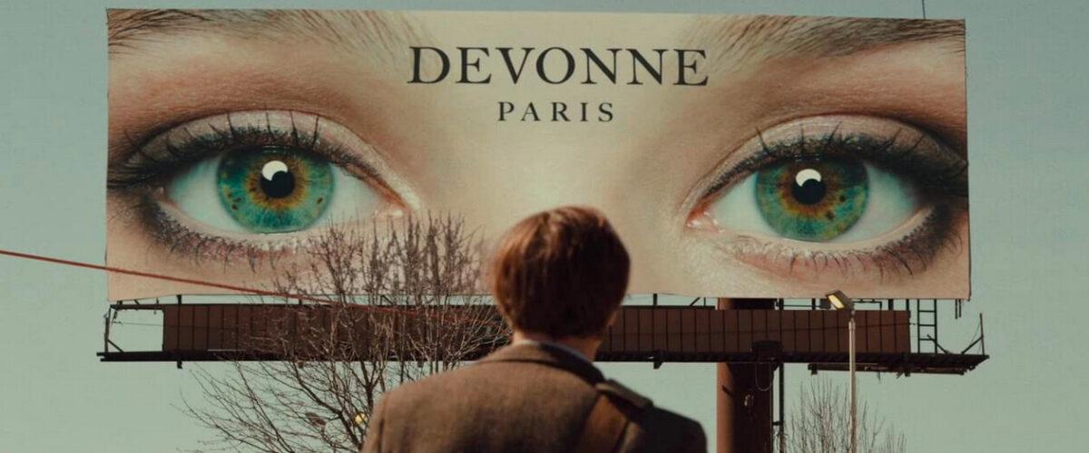 A billboard featuring eyes in I Origins