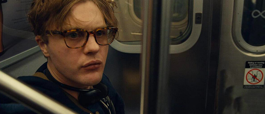 man with glasses in subway in I Origins