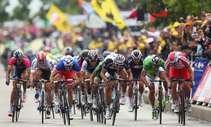 Marcel Kittel Giant-Shimano (C) sprints to win Stage Four of the 2014 Tour de France, 163 km from Le Touquet-Paris-Plage to Lille, on July 8, 2014 in Lille, France. (Bryn Lennon/Getty Images)