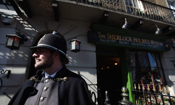 A man in a Victorian Period police costume stands outside the Sherlock Holmes Museum in 2012, located at 221B Baker St. London, England, the fictional address of the Sherlock Holmes character. Holmes had many villains, but none so trying as Professor Moriarty who was inspired by a real-life master criminal named Adam Worth. (Dan Kitwood/Getty Images)