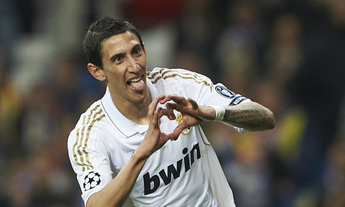 Angel Di Maria of Real Madrid celebrates after scoring during the UEFA Champions League quarter-final second leg match between Real Madrid and APOEL FC at Bernabeu on April 4, 2012 in Madrid, Spain. (Manuel Queimadelos Alonso/Getty Images)