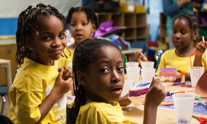 Students participate in a Summer Quest art class at P.S. 154 School in the South Bronx, New York, July 15, 2014. (Petr Svab/Epoch Times)