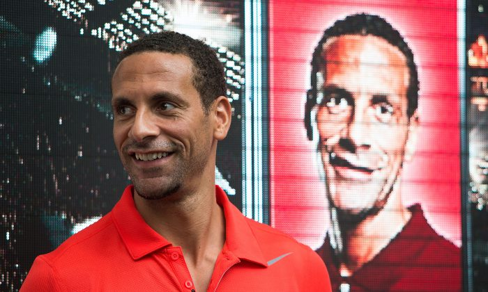 Rio Ferdinand greets supporters during a meet-the-fans session on May 16, 2014 in Singapore. (Nicky Loh/Getty Images)
