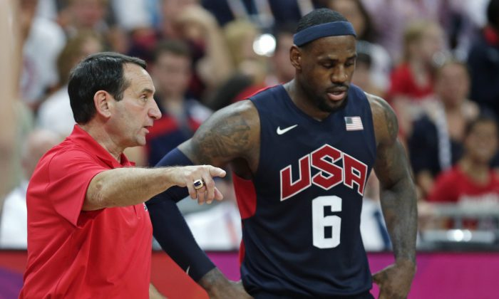 In this Aug. 4, 2012, file photo, United States coach Mike Krzyzewski talks with LeBron James during a men's basketball game against Lithuania at the 2012 Summer Olympics in London. (AP Photo/Charles Krupa, File)