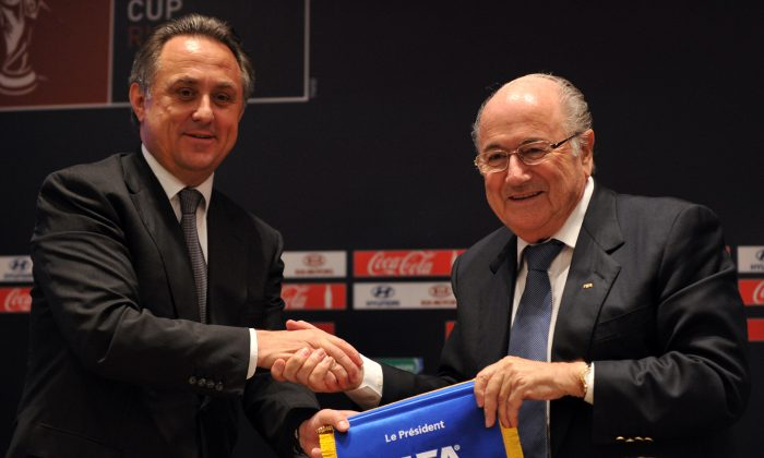 FIFA president Sepp Blatter (R) shakes hands with Russian Sports Minister Vitaly Mutko (L) after their news conference in Moscow on September 30, 2012. Russia and FIFA on Saturday unveiled the 11 cities from the Baltic to the Urals that will host the 2018 World Cup in the most ambitious project the country has organised since the fall of the USSR. (YURI KADOBNOV/AFP/GettyImages)