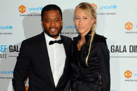 Manchester United's captain Patrice Evra and wife Sandra pose for pictures as they arrive for the 13th annual United for UNICEF charity gala dinner at Old Trafford in Manchester, north-west England on December 19, 2012. The event marks 13 years of partnership between Manchester United and UNICEF and raises funds for the charity to support their work around the world for vulnerable children. (HOWARD WALKER/AFP/Getty Images)