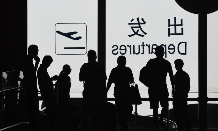 Over one hundred flights between Beijing and Shanghai were canceled in the afternoon of July 14, allegedly due to military exercises, according to state news media in China. (GREG BAKER/AFP/Getty Images)