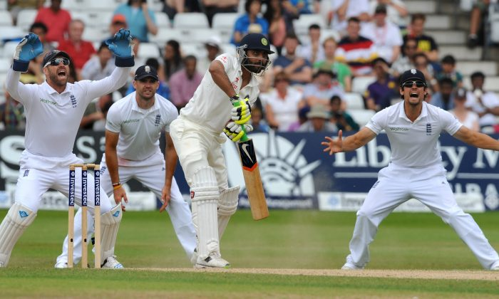 England's Matt Prior, left, James Anderson and Alastair Cook react as India's Ravindra Jadeja as plays a shot, during day five of the first Test between England and India at Trent Bridge cricket ground, Nottingham, England, Sunday, July 13, 2014. (AP Photo/Rui Vieira)
