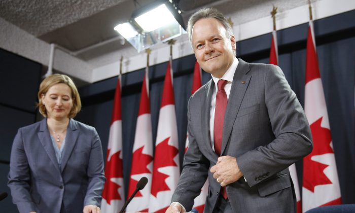 Bank of Canada governor Stephen Poloz and senior deputy governor Carolyn Wilkins take part in a news conference in Ottawa on July 16, 2014. (Reuters/Blair Gable)