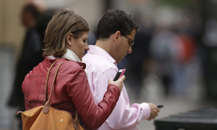 Although charges are coming down for Canadian cellphone users, they remain substantially higher compared to many other countries. (AP Photo/Ben Margot, File)