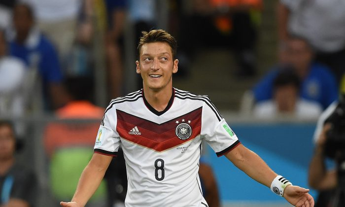 Germany's midfielder Mesut Ozil reacts during the second half of the 2014 FIFA World Cup final football match between Germany and Argentina at the Maracana Stadium in Rio de Janeiro on July 13, 2014. (PEDRO UGARTE/AFP/Getty Images)