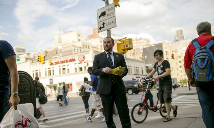 Council member Corey Johnson hands out fliers to raise awareness of paid sick leave in Chelsea on Wednesday. (William Alatriste/City Council)