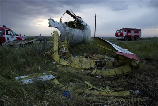 Fire engines arrive at the crash site of a passenger plane near the village of Hrabove, Ukraine, as the sun sets Thursday, July 17, 2014. Ukraine said a passenger plane carrying 295 people was shot down Thursday as it flew over the country. (AP Photo/Dmitry Lovetsky)