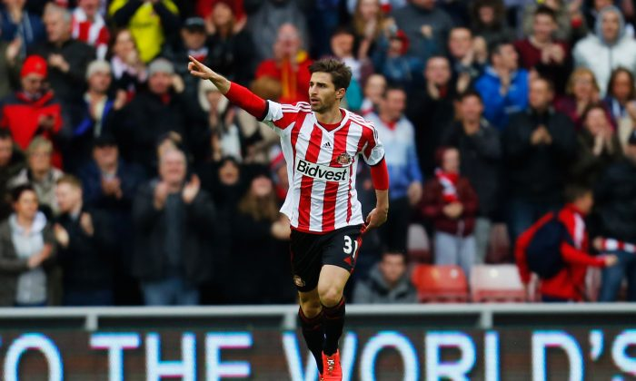 Fabio Borini of Sunderland celebrates as he scores their first goal during the Barclays Premier League match between Sunderland and Swansea City at Stadium of Light on May 11, 2014 in Sunderland, England. (Photo by Paul Thomas/Getty Images)