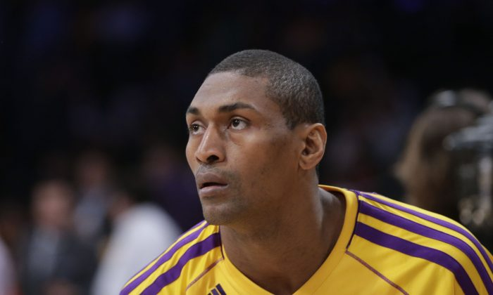 Los Angeles Lakers' Metta World Peace looks on during practice for an NBA basketball game against the Houston Rockets in Los Angeles, Wednesday, April 17, 2013. (AP Photo/Jae C. Hong)