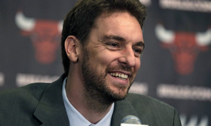 The Chicago Bulls newest acquisition, free agent forward/center Pau Gasol, speaks at an NBA news conference Friday, July 18, 2014, in Chicago. The Bulls are hoping Gasol will help bolster their offensive attack after they struggled to score at times last year. (AP Photo/M. Spencer Green)