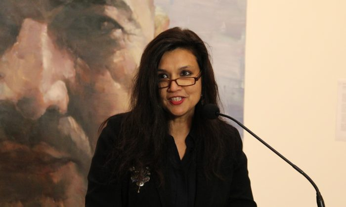 Suhanya Raffel, Director of Collections at the Art Gallery of New South Wales, speaking at the the gallery on the announcement of the finalists for the 2014 Archibald Prize. (Shar Adams/Epoch Times)