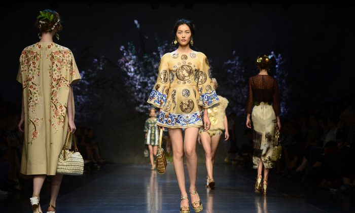 Chinese model Liu Wen presents a creation for fashion house Dolce & Gabbana as part of the spring/summer 2014 ready-to-wear collections during the fashion week in Milan on September 22, 2013. (OLIVIER MORIN/AFP/Getty Images)