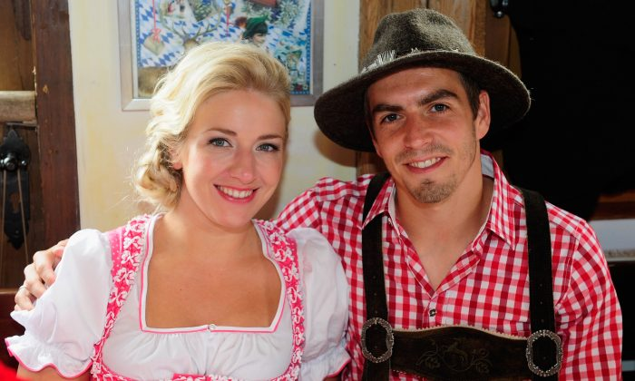 Philipp Lahm of Bayern Muenchen and his wife Claudia Lahm attend the Oktoberfest 2013 beer festival at Kaefers Wiesenschaenke on October 6, 2013 in Munich, Germany. (Lennart Preiss/Bongarts/Getty Images)