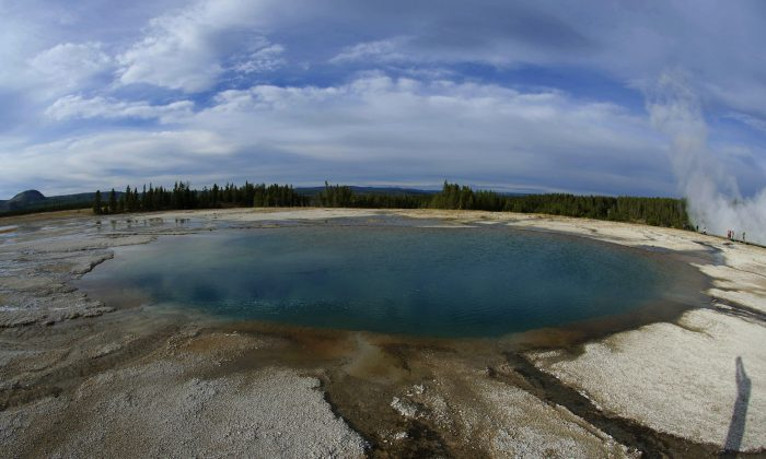 Turquoise Pool is shown at the Midway Geyser Basin October 8, 2012 in Yellowstone National Park in Wyoming.Yellowstone protects 10,000 or so geysers, mudpots, steamvents, and hot springs.Yellowstone National Park is America's first national park. It was established in 1872. Yellowstone extends through Wyoming, Montana, and Idaho.  The park's name is derived from the Yellowstone River, which runs through the park. (AFP PHOTO/Karen BLEIER)