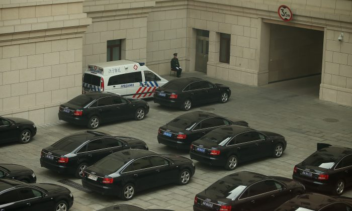 A soldier guards top leaders' cars inside the Great Hall of the People during a meeting of the National People's Congress on March 8, 2013 in Beijing, China. On July 16, China formally released a reform program for reducing officials' use of publicly provided cars. (Feng Li/Getty Images)