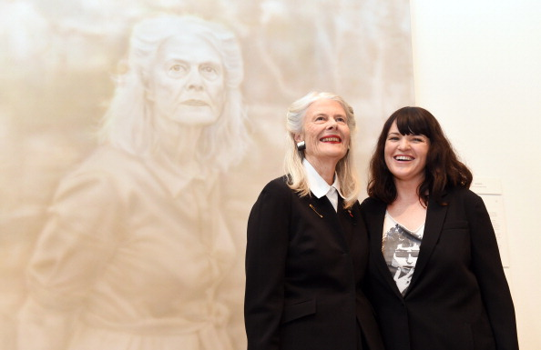 Artist Fiona Lowry (L) stands in front of her portrait of Penelope Seidler (L) after winning the Archibald Prize for portraiture at the Art Gallery of NSW in Sydney on July 18, 2014. The painting was one of 884 entries including 54 finalists vying for the prestigious $75,000 award. (William West/AFP/Getty Images)