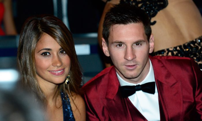 Barcelona's Argentine forward Lionel Messi (R) and Antonella Roccuzzo attend the 2013 FIFA Ballon d'Or award ceremony at the Kongresshaus in Zurich on Jan. 13, 2014. (OLIVIER MORIN/AFP/Getty Images)