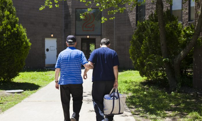 Anthony Cosentino and his son, John Cosentino, at the Brooklyn Developmental Center, June 20, 2014. The center is one of the two developmental centers in NYC that are slated to close under Governor Cuomo's initiative to transition adults with developmental disorders from institutions to group homes. Some fear group homes cannot adequately care for those who have severe disorders. (Samira Bouaou/Epoch Times)