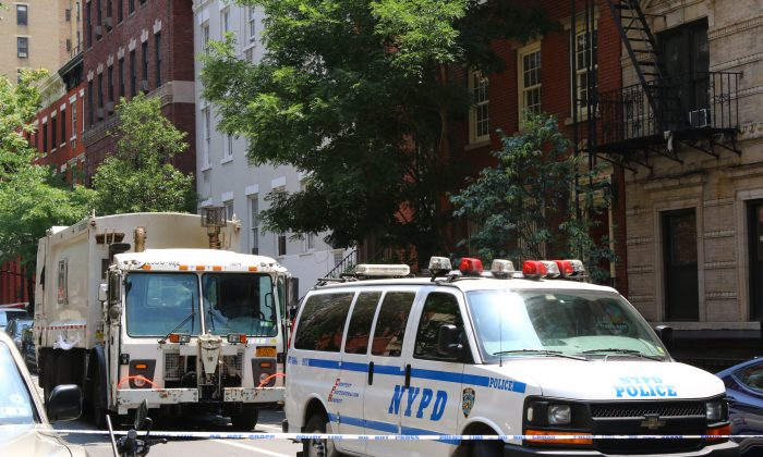 The sanitation truck that killed 58-year-old Jackie Haeflinger in the West Village, on Wednesday, July 3, 2014. (Brendon Fallon/Epoch Times)