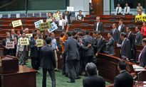 Pan-Democrats Walk Out on Hong Kong Chief Executive