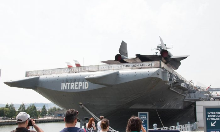 The decommissioned USS Intrepid featured at the Intrepid Sea, Air & Space Museum was the site of a transformer malfunction that left three people injured, Manhattan, on July 8, 2014. (Brendon Fallon/Epoch Times)