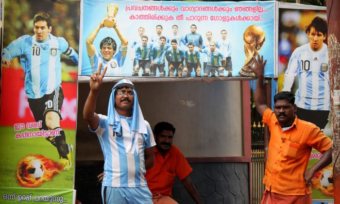 An Argentina soccer team fan on a roadside, shows the victory sign ahead of the Argentina–Netherland's match on Wednesday at Thrissur, India on July 9. Soccer is extremely popular in the region from central to northern Kerala called the Malabar coast of India. (Venus Upadhayaya/Epoch Times)