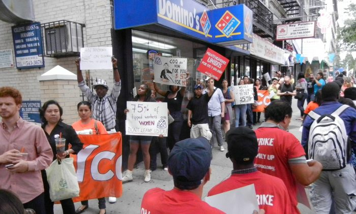Food service workers and activists rally for a higher minimum wage for tipped employees outside of a Domino's Pizza restaurant in the Washington Heights neighborhood of Manhattan on July 10, 2014. (Jonathan Zhou/Epoch Times)