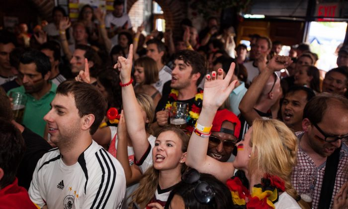 Fans of Germany cheer on their team in Zum Schneider pub during the Wolrd Cup final against Argentina. East Village, Manhattan, New York, July 13, 2014. (Petr Svab/Epoch Times)