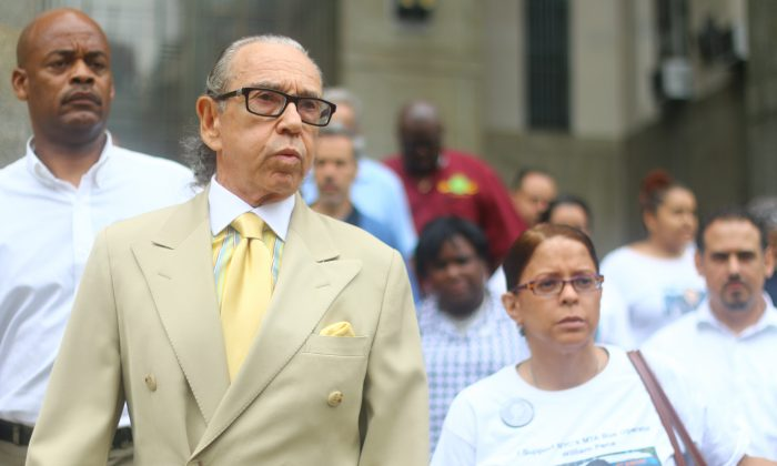 William Pena's common law wife Nancy Rodriguez (R) with lawyer Sanford Rubenstein outside the Supreme Court, New York, Monday, July 14, 2014. Rodriguez and Rubenstein strongly supported the Court's decision to uphold a felony murder charge against the man who allegedly drove a stolen truck into a bus driven by Rodriguez's long-term partner, killing him.(Brendon Fallon/Epoch Times)