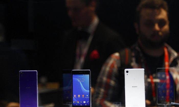 A visitor looks at the Sony Xperia Z2 during a press conference at the Mobile World Congress in Barcelona, on February 24, 2014. The Mobile World Congress runs from the 24 to 27 February where participants and visitors alike can attend conferences, network, discover cutting-edge products and technologies at among the 1,700 exhibitors as well as seek industry opportunities and make deals. (QUIQUE GARCIA/AFP/Getty Images)