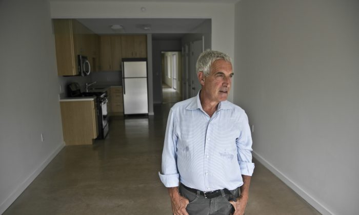 Developer Jeffrey M. Brown tours a studio apartment in the seven-story modular-built apartment building called the Stack he co-developed, in the Innwood neighborhood of Manhattan on July 9, 2014. The Stack's 28 apartments, from studios to three bedroom, were formed from 59 modules of rectangular components all 12.5 feet wide and 50 to 60 feet long. (AP Photo/Bebeto Matthews)