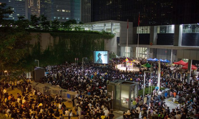 "Thousands jam Civic Square in Hong Kong protesting the denial of a broadcast license to Hong Kong Television Network on Oct. 21, 2013 in Hong Kong. A government press release announcing the fencing off of this square referred to ""recent public order events,"" which is believed to be a reference to protests like this one. (Lam Yik Fei/Getty Images)"