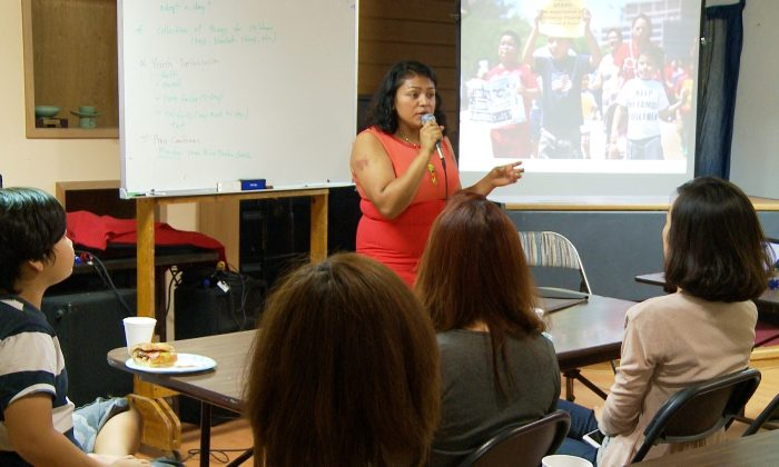 Yamilex Rustrian gives a presentation at the Korean Resource Center in Los Angeles on July 17. She is helping organize a five-day fast called Children Over Politics that began Monday, July 21. (Andrew Li/Epoch Times Staff)