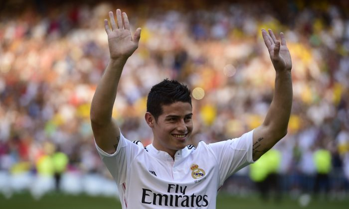 Colombian striker formerly at AS Monaco James Rodriguez poses during his presentation at the Santiago Bernabeu stadium following his signing with Spanish club Real Madrid in Madrid on July 22, 2014. Spanish media said Real paid about 80 million ($108m) for Rodriguez, making him one of the most expensive players ever. Neither club gave a figure, but Monaco said it was 'one of the biggest transfers in football history.' (PIERRE-PHILIPPE MARCOU/AFP/Getty Images)