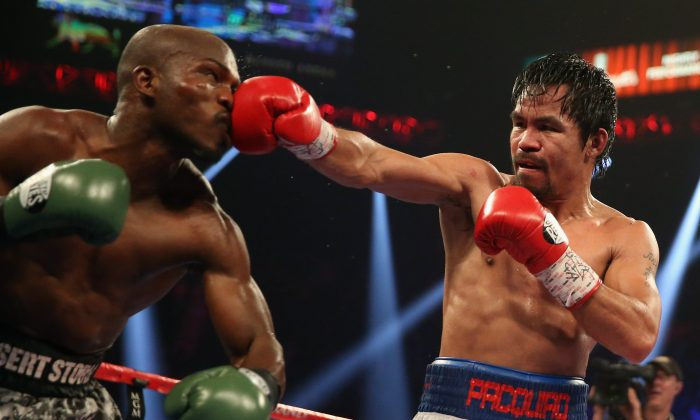 Manny Pacquiao throws a right hand at Timothy Bradley at the MGM Grand Garden Arena on April 12, 2014 in Las Vegas, Nevada. (Jeff Gross/Getty Images)