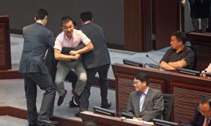 Hong Kongers Accuse Chief Executive of Falsifying Report